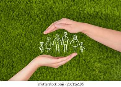 Two Woman's open hands making a protection gesture  isolated on green background.Family life insurance, protecting family, family concepts.