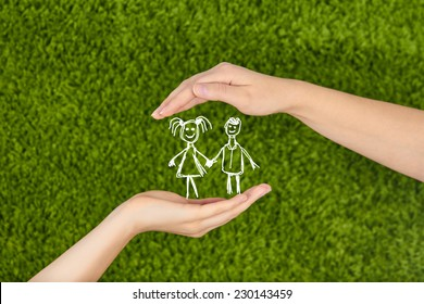 Two Woman's open hands making a protection gesture  isolated on green background.Family life insurance, protecting children.