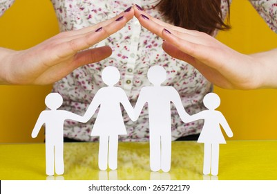 Two Woman's open hands making a protection gesture with isolated on green background.Family life insurance, protecting family, family concepts.