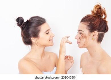 two women applying exfoliating