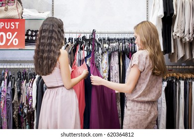 Two women at a boutique together.
