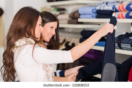 Two Women Buying Shirt, Indoors