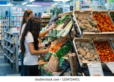 Two women buying in the supermarket