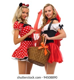 Two women in carnival costume.   Little Red Riding Hood and mouse shape. Isolated image