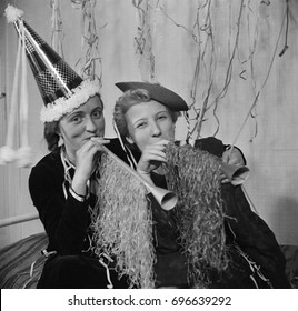 Two women celebrating and having fun at party