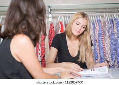 two women choosing clothes in a shop