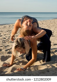 Two women dance a contact improvisation in nature