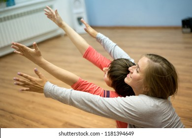 Two women dancing dance contact improvisation