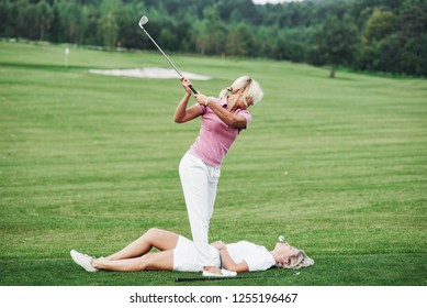 Two women decides to play the golf a little bit another way. Try this is at your own risk.