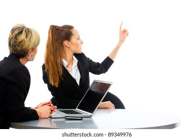 two women during a business meeting with laptop on white background studio