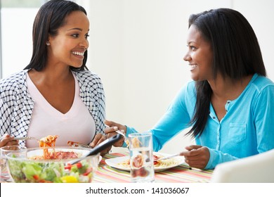 Two Women Eating Meal Together At Home