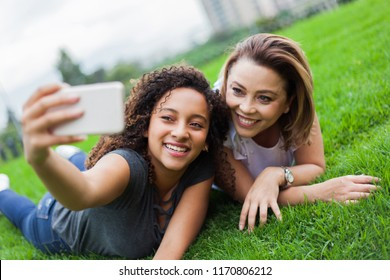 Two women, face down in the ceped taking a selfie