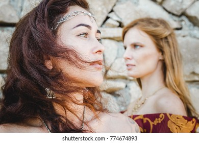 two women faces that stand back to wall