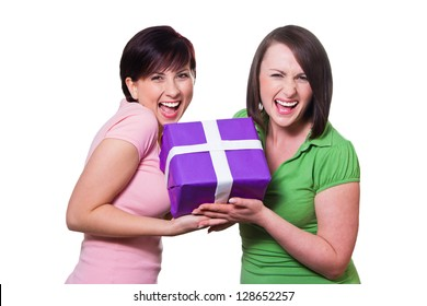 Two women give a gift