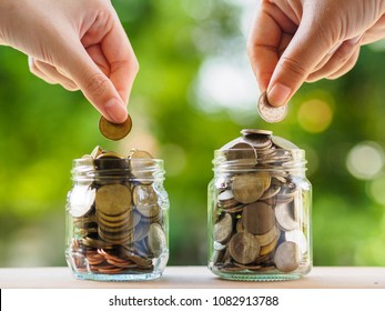Two women hand putting money coin into glass jar for saving money. saving money and financial concept