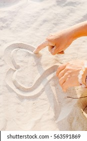 Two Women Hands Draw Heart on Sand Closeup Love Concept Symbol
