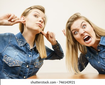 Two women having argue mocking up being mad at each other. Female telling off, ignorance concept.