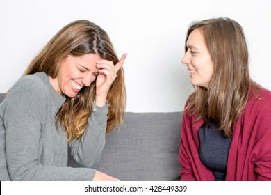 Two women having fun while talking