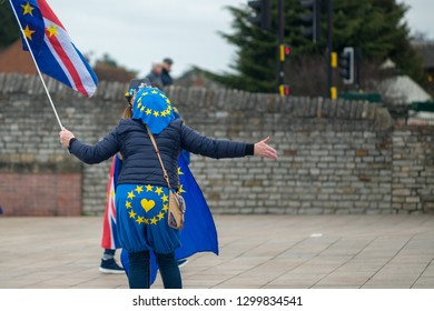 two women having heated debate or argument in the street about leaving or remaining and Brexit