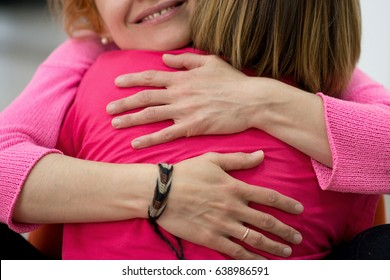 Two women are hugging
