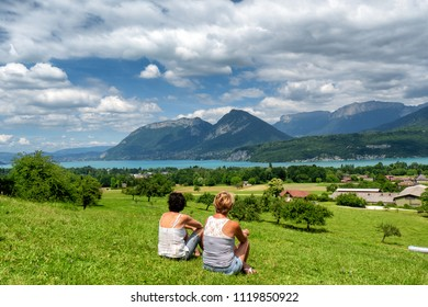 two women looking at the Annecy lake in France