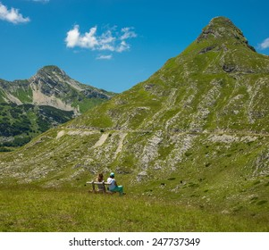 Two women looking at the mountain Durmitor. Montenegro.