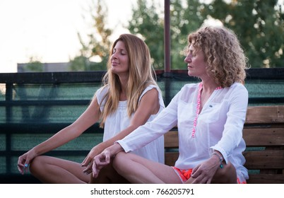 Two women meditating after yoga
