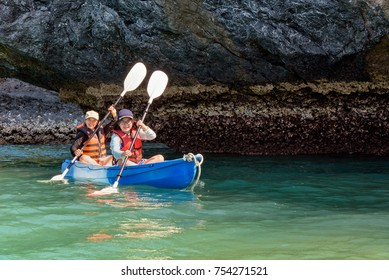 Two women are mother and daughter. Travel by boat with a kayak happy under at summer around Ko Phi view the beautiful nature of the sea and island, Mu Ko Ang Thong National Park, Surat Thani, Thailand