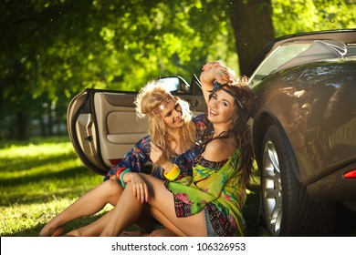 Two women next to the car
