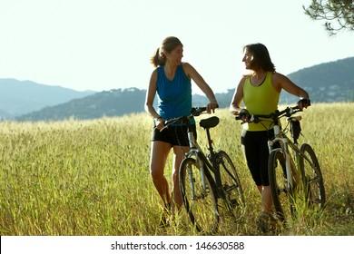 Two women on a bike ride