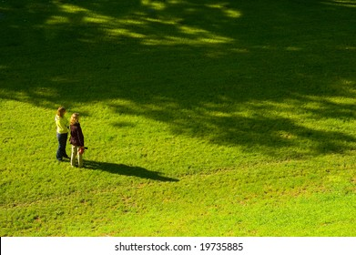 Two women on the bright grass