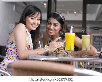 Two women at outdoor garden cafe