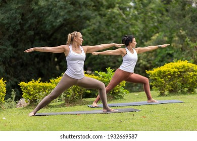 two women practicing yoga in a park, Barueri, São Paulo, Brazil