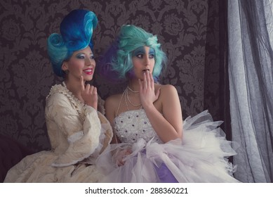 Two women in prom or historical dresses