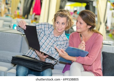 two women reading a report
