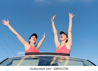 Two women in roof car with funny and freedom expression