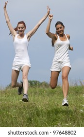 two women running downhill
