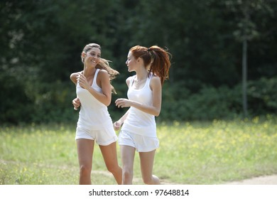 two women running outdoors in a sunny day