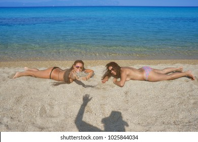 Two Women Shadow Beach Waving