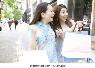 Two women shopping in the city