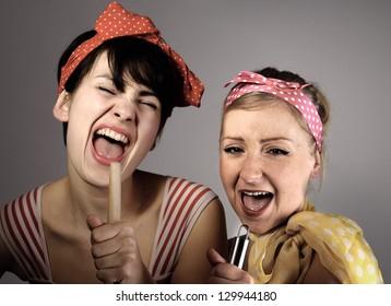 Two women singing together. Karaoke, retro style.