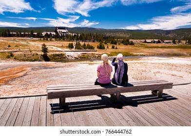 Two women sitting on a bench in the Yellostone national park