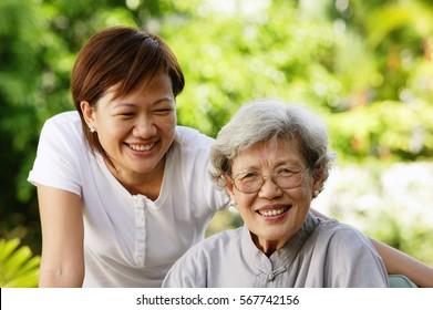 Two women, smiling at camera