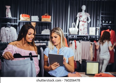 Two women in a store checking availability of the product