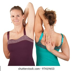 Two women stretch their shoulders over white background