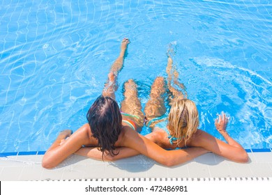 Two women at the swimming pool