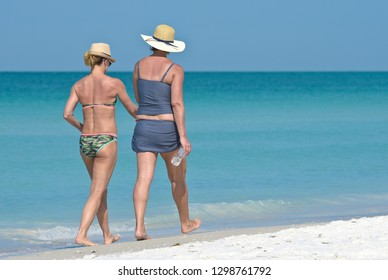 Two Women Taking a Leisure Walk on the Beach in Florida