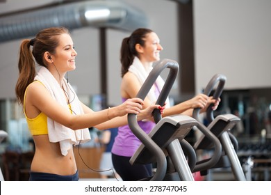 Two women training in a gym