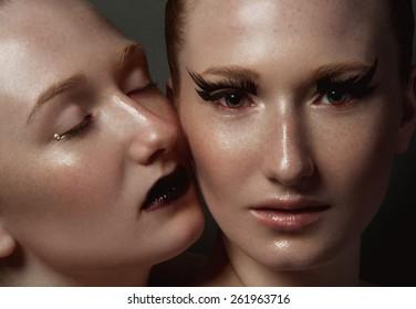 Two women. Twins girl. Redhead. Beautiful portrait