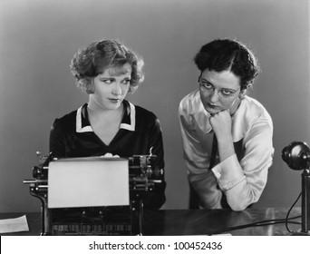 Two women with typewriter